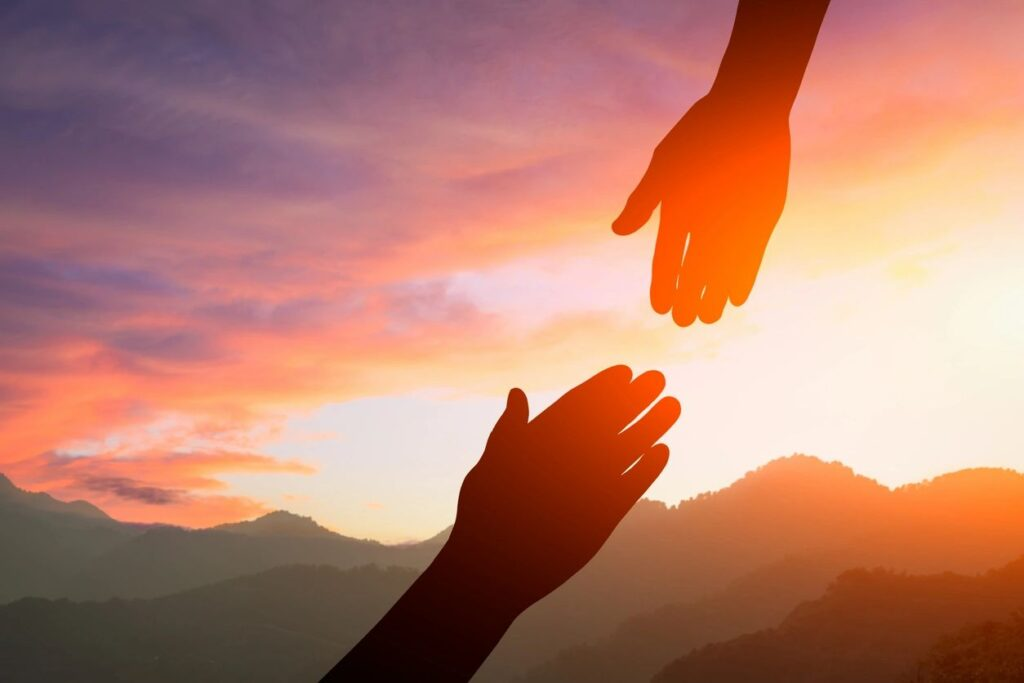 Image for Get a Literary Agent - hand reaching to help another hand