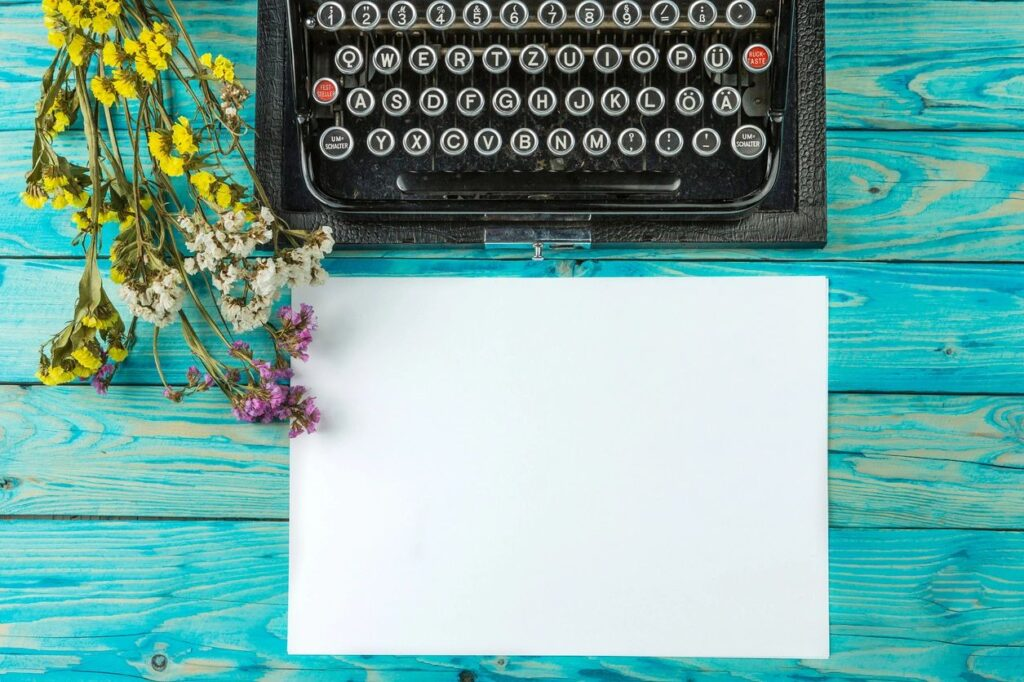 Typewriter, paper and flowers for Fall 2020 Writing Coures